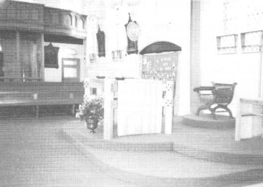 July 1990 a new altar sits half way down the church in front of the now disused confessionals